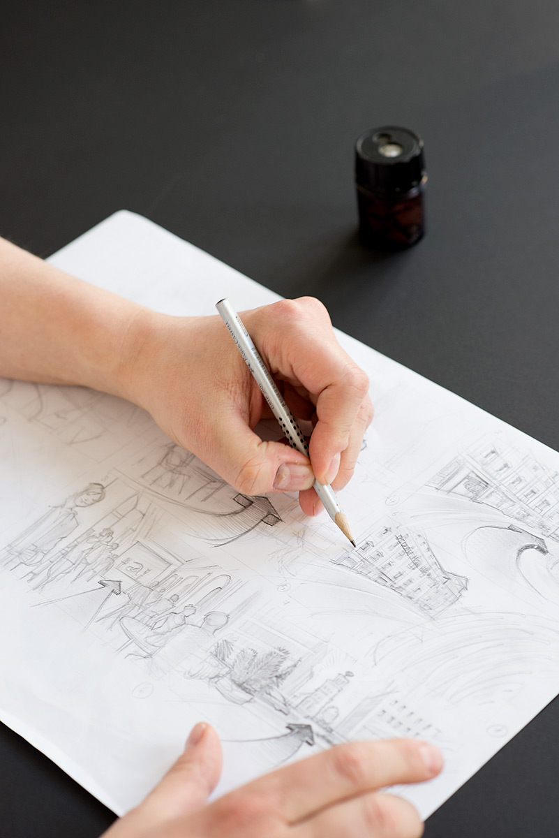 Businessfotografie - Hand mit Bleistift beim Zeichnen eines Storyboards |Felix Krammer Fotografie